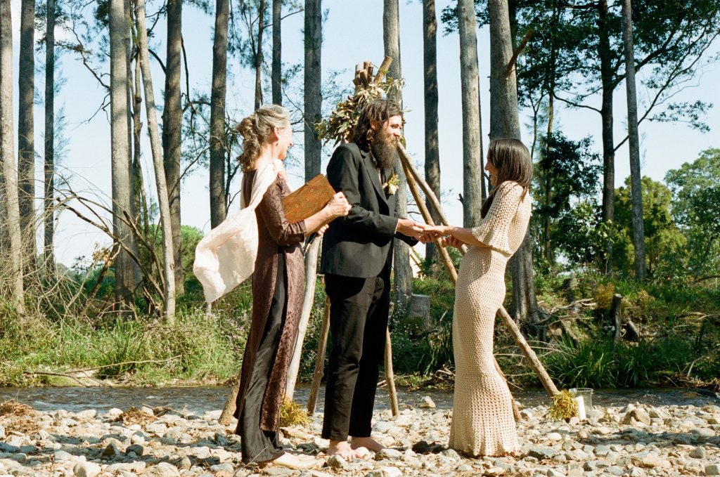 Harriet and Lachlan and Linda, the celebrant, at the wedding ceremony which was held by the banks of the Never Never River at Glennifer near Bellingen